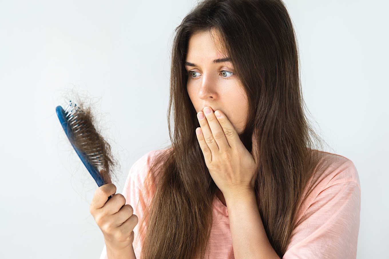 woman hair loss brush