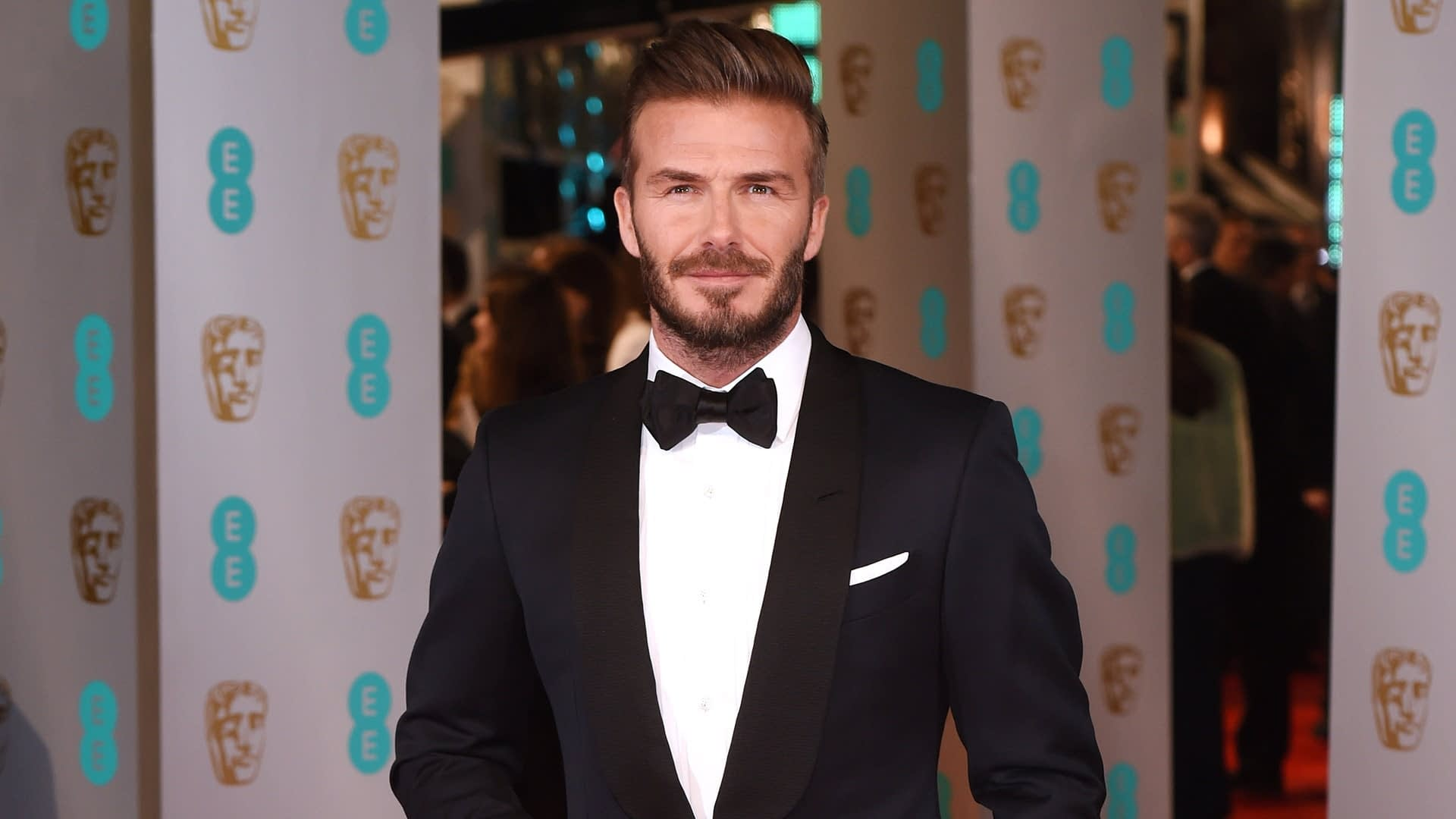 celebrity david beckham in tuxedo hair transplant