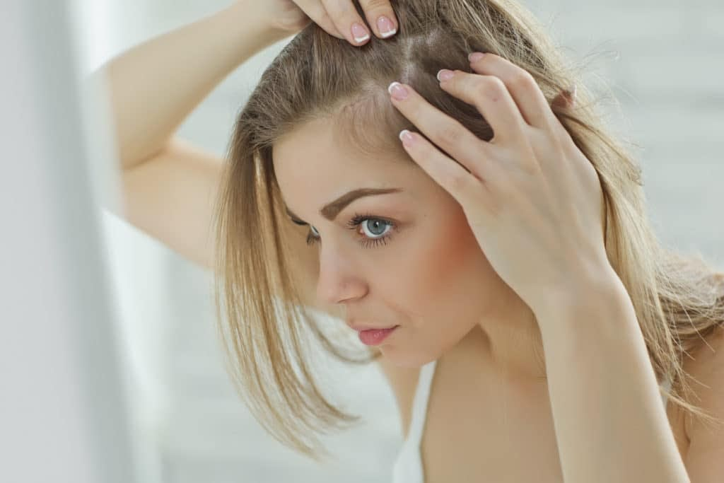 woman stressed out from hair loss