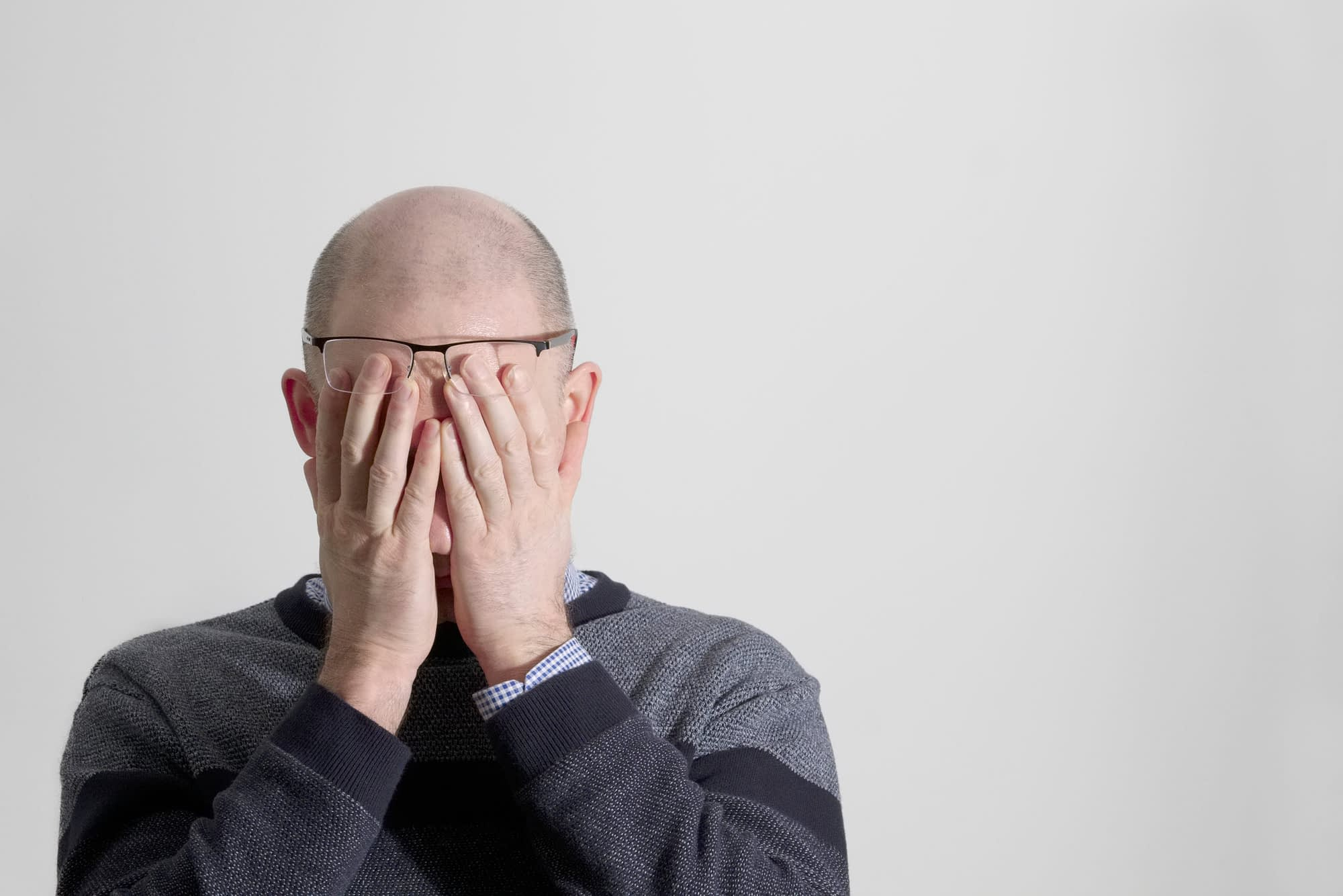 bald guy stressed out